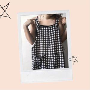 Black and white checkered overalls
